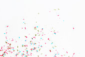 Colorful candy sprinkles on the white background