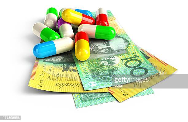 Colorful capsules on Australian Dollar notes