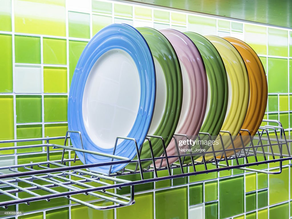 Colorful ceramic plates in modern kitchen  Stock Photo & Colorful Ceramic Plates In Modern Kitchen Stock Photo | Thinkstock