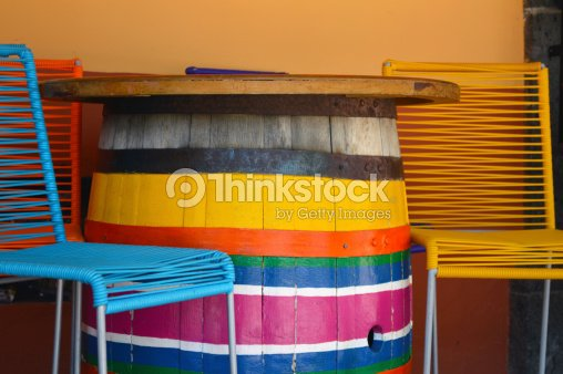 Colorful Chairs And Barrel Table On Mexican Plaza