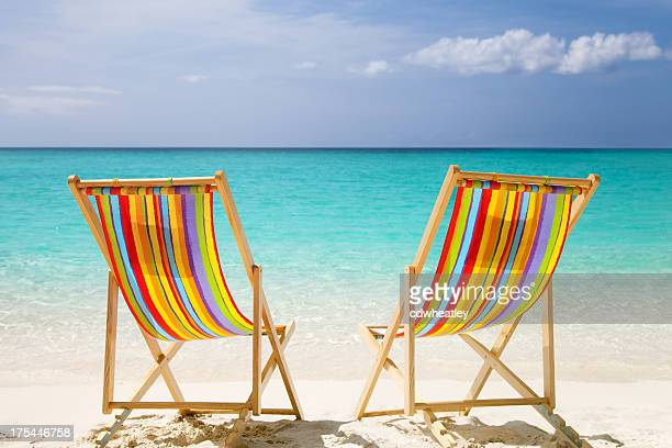 colorful chairs at a topical Caribbean beach