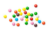 Colorful chocolate candy pills isolated on white background. Top view
