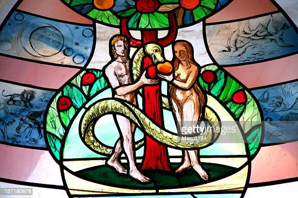 colorful church window with adam and eve