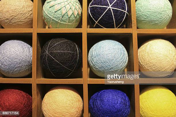 colorful clews in wooden box