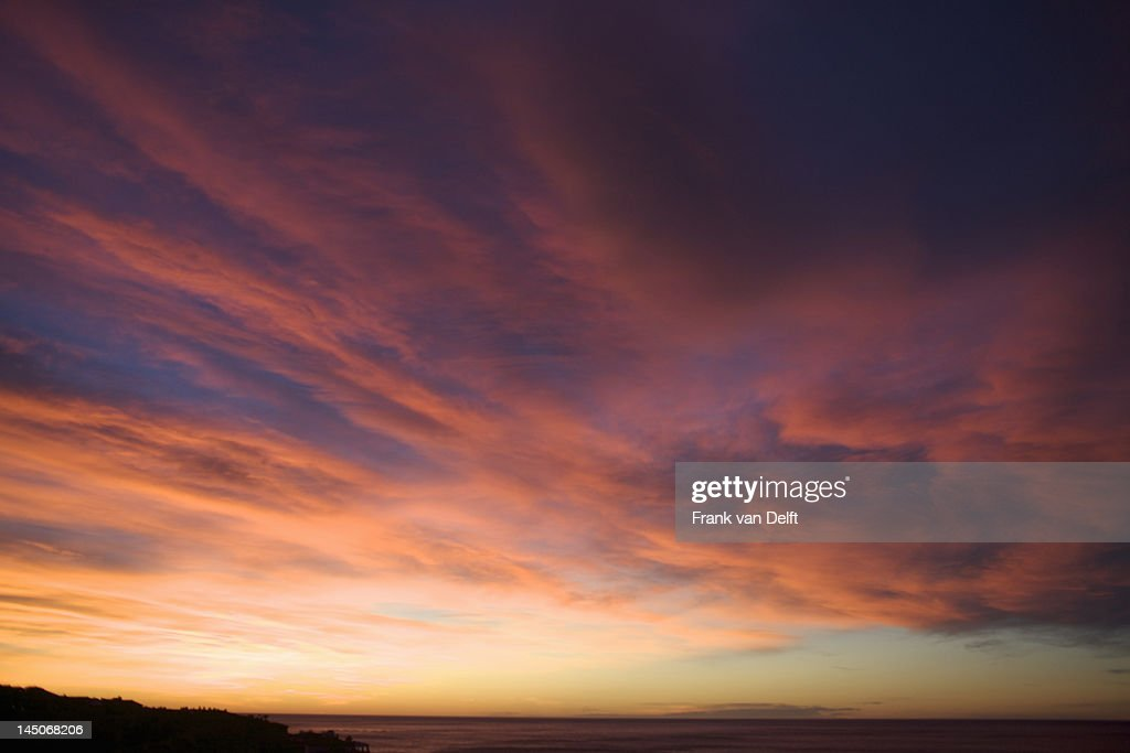 Colorful clouds in sunset sky : Stock Photo