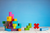 Colorful constructor, logic game, cubic mosaic. Design created by cubes. The concept of logical thinking, geometric shapes.