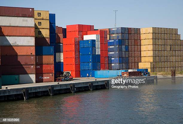 Colorful containers stacked on quayside Port of Rotterdam Netherlands