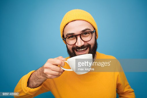 Colorful content man drinking coffee : Stock Photo