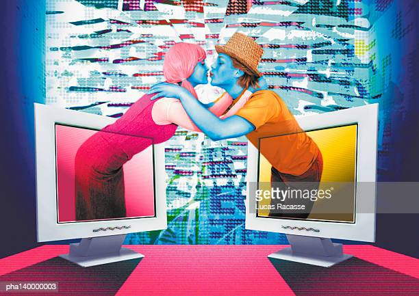 Colorful couple emerging from two computer monitors, embracing, digital composite.