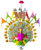 Colorful craft made elaborate Thai traditional Krathin Buddhist ceremony money tree offering, complete with Thai bank notes, in the shape of a peacock, isolated on white, clipping path included. This