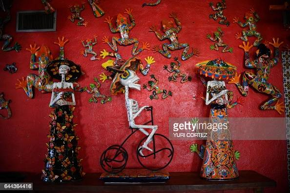 TOPSHOT Colorful crafts that represent the Mexican character of La Catrina are sold in a store in Puerto Palomas on February 19 northern Mexico where...