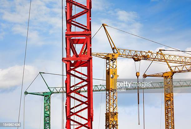 Colorful cranes against blue sky