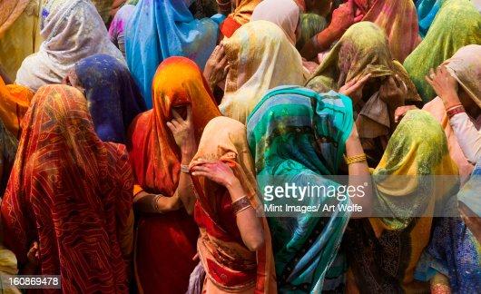 A colorful crowd of people celebrate the Holi Festival, Mathura, Uttar Pradesh, India