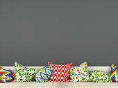 Colorful cushions on the background of a gray wall