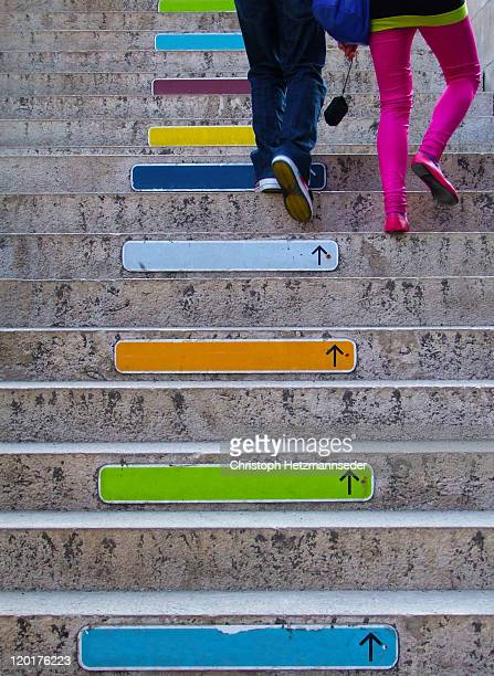 Colorful direction signs on stairs