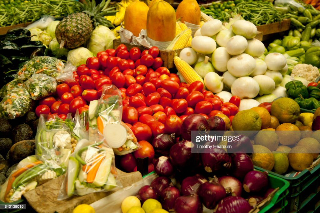 Colorful display of various fruits and vegetables at a market : Stock Photo