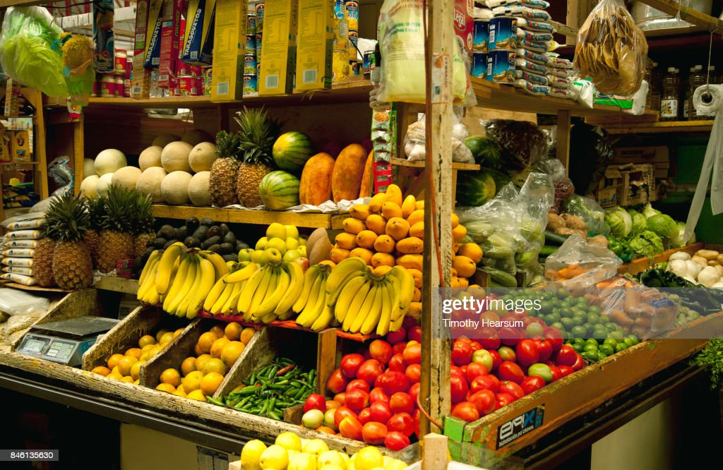 Colorful display of various fruits, vegetables and other products at a market : Stock Photo