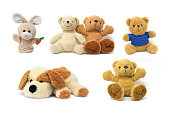 Colorful Doll and Toys Collection teddy bear,plush toy dog and rabbit sock puppet isolated on white background