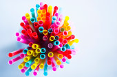 Colorful drinking straws. Top view. Small Dof.