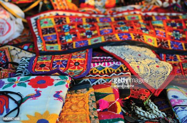 Colorful embroidery handicraft, handbags and purses at market for sale - art of india