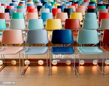 colorful empty chairs in theater