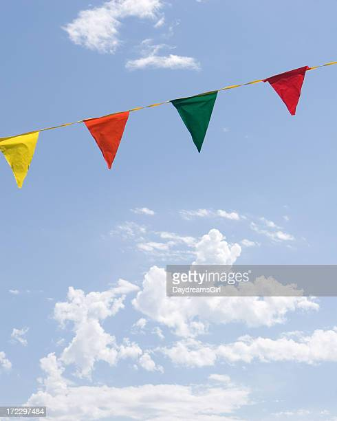 Colorful Festive Flags and Blue Sky with White Clouds