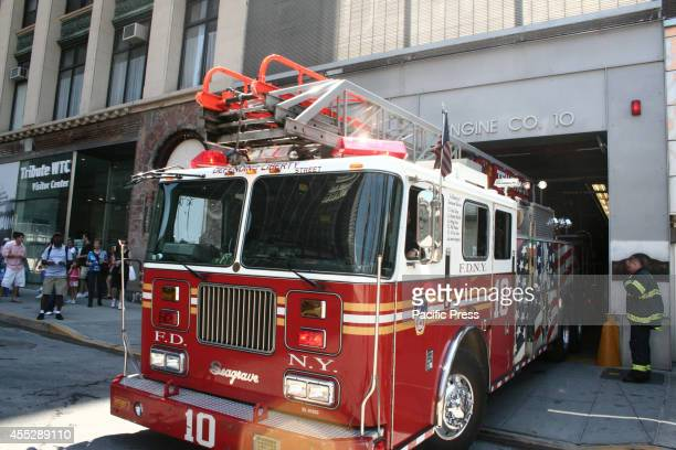Colorful fire trucks near the World Trade Center Year 2014 marks the 13th anniversary of the September 11th terrorist attacks that killed nearly 3000...