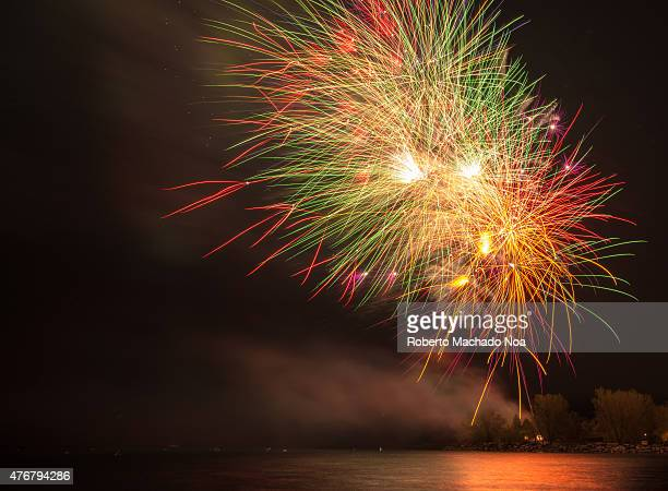 S BAY TORONTO ONTARIO CANADA Colorful fireworks in the night sky with reflection on the water surface Fireworks during Victoria Day in Ashbridge's...