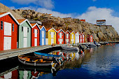 Colorful fishing huts at water