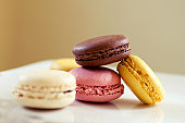Colorful french macaroon cookies on plate