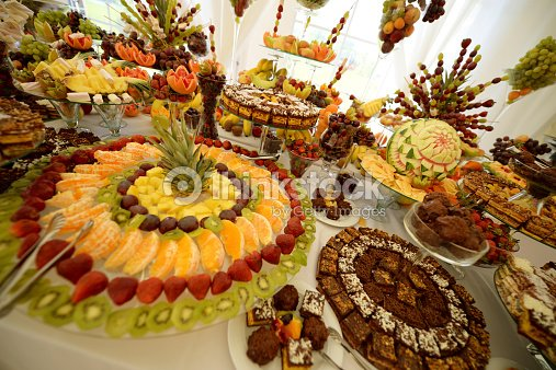 Colorful Fruits And Cakes On Table At A Wedding Stock Photo | Thinkstock