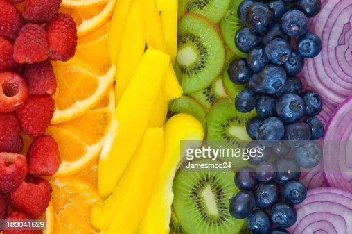 Colorful fruits and vegetables arranged in rainbow