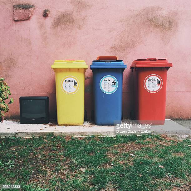 Colorful Garbage Bins Outside House