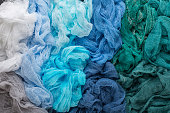 Multicolored background of blue, blue, green, blue-salted, turquoise colors of gauze fabric.