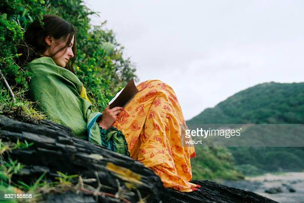 Colorful girl reading in nature