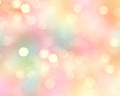 Spring Easter holiday glitter blurred colorful bokeh background.