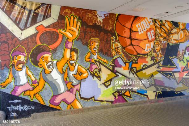 Colorful graffiti is sprayed at a house wall in the township Neustadt