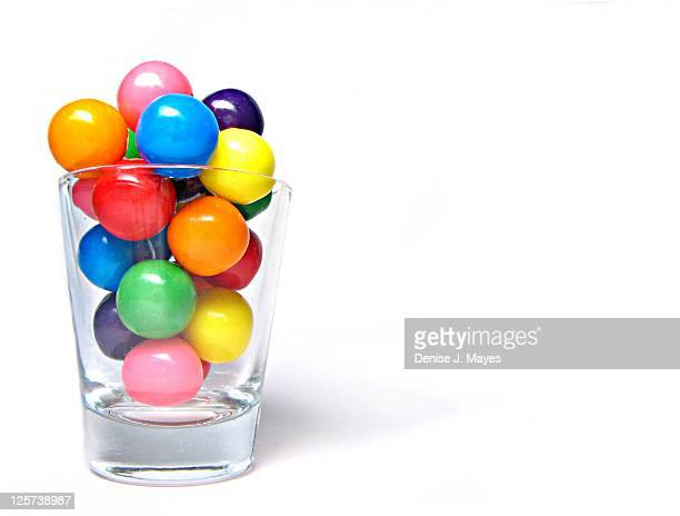 Colorful gumballs in shot glass