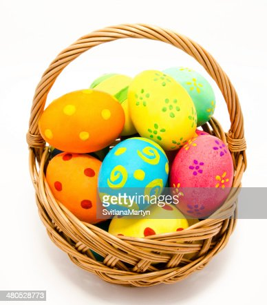 Colorful handmade easter eggs in the basket isolated : Stock Photo