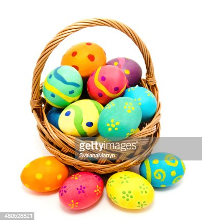 Colorful handmade easter eggs in the basket isolated : Stockfoto