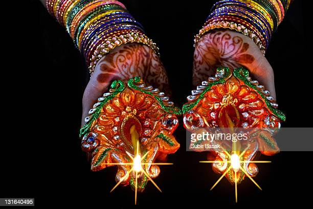 Colorful hands holding lamps