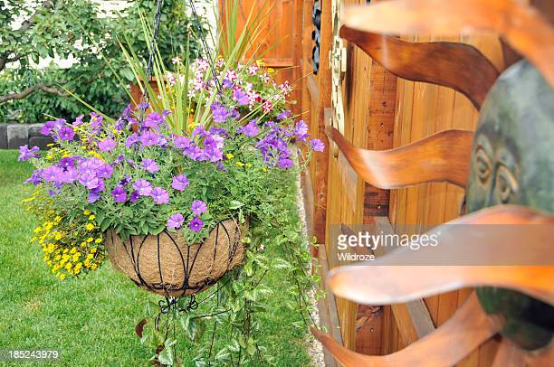 Colorful hanging basket of flowers in backyard