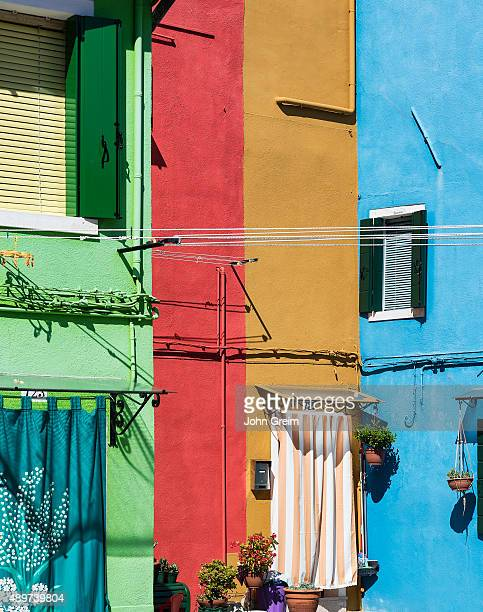 BURANO VENICE VENETO ITALY Colorful home facades in the Venetian fishing village on the island of Burano Italy