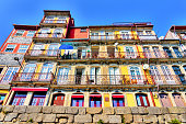 Colorful residential building in the Ribeira neighborhood of Porto, Portugal; low angle view