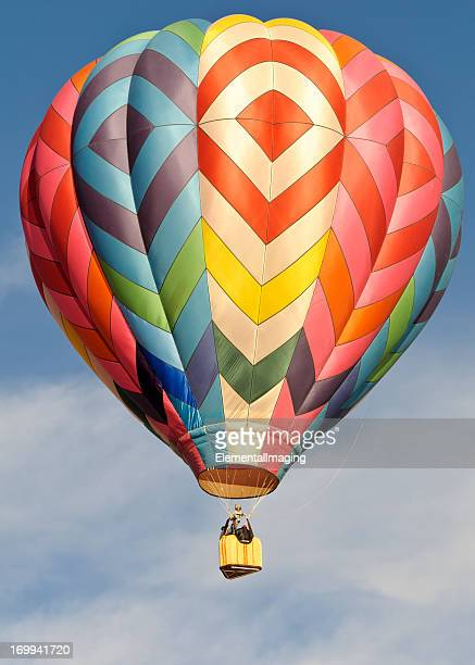 Colorful Hot Air Balloon with Wispy Clouds