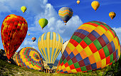Colorful hot air balloons against blue sky at Cappadocia Turkey