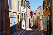 Colorful house exteriors along alleyway, Marseille, France