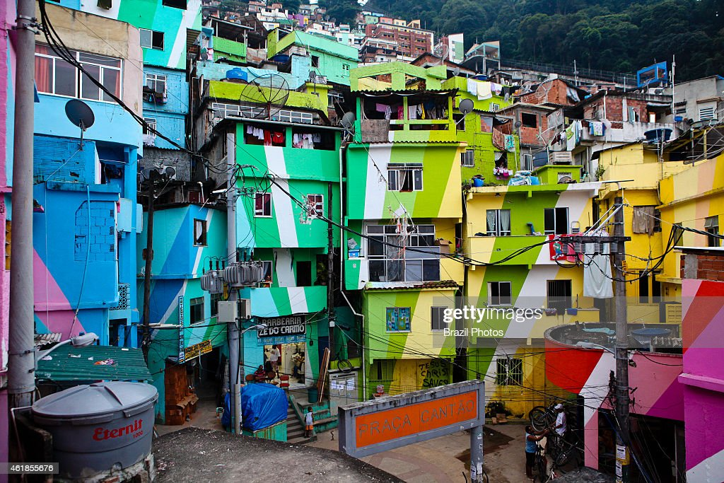 Colorful houses at Favela Santa Marta the first Rio de Janeiro favela to have an UPP in 2008 English signs indicating the location of attractions are...