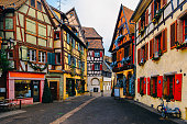 Street view with traditional half timbered colorful houses with noel ornaments of Colmar in the region of Alsace on the French border with Germany.