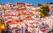 Elevated view on colorful Ibiza Down Town at dusk.